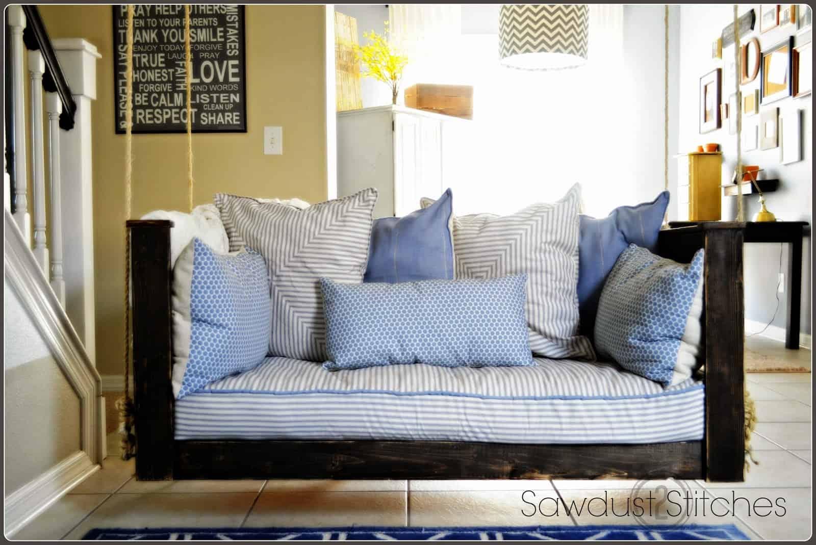 Wood and crib mattress porch swing