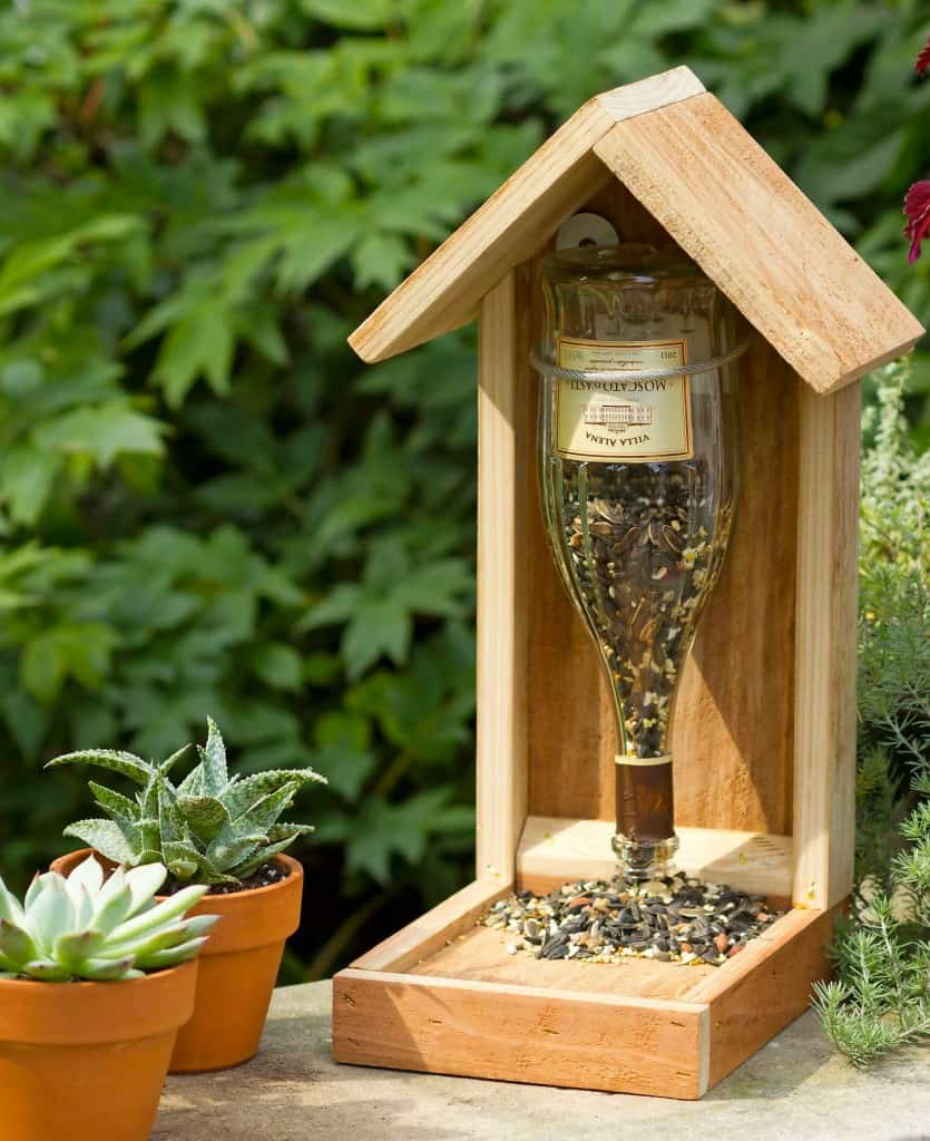 Wood and wine bottle bird feeder