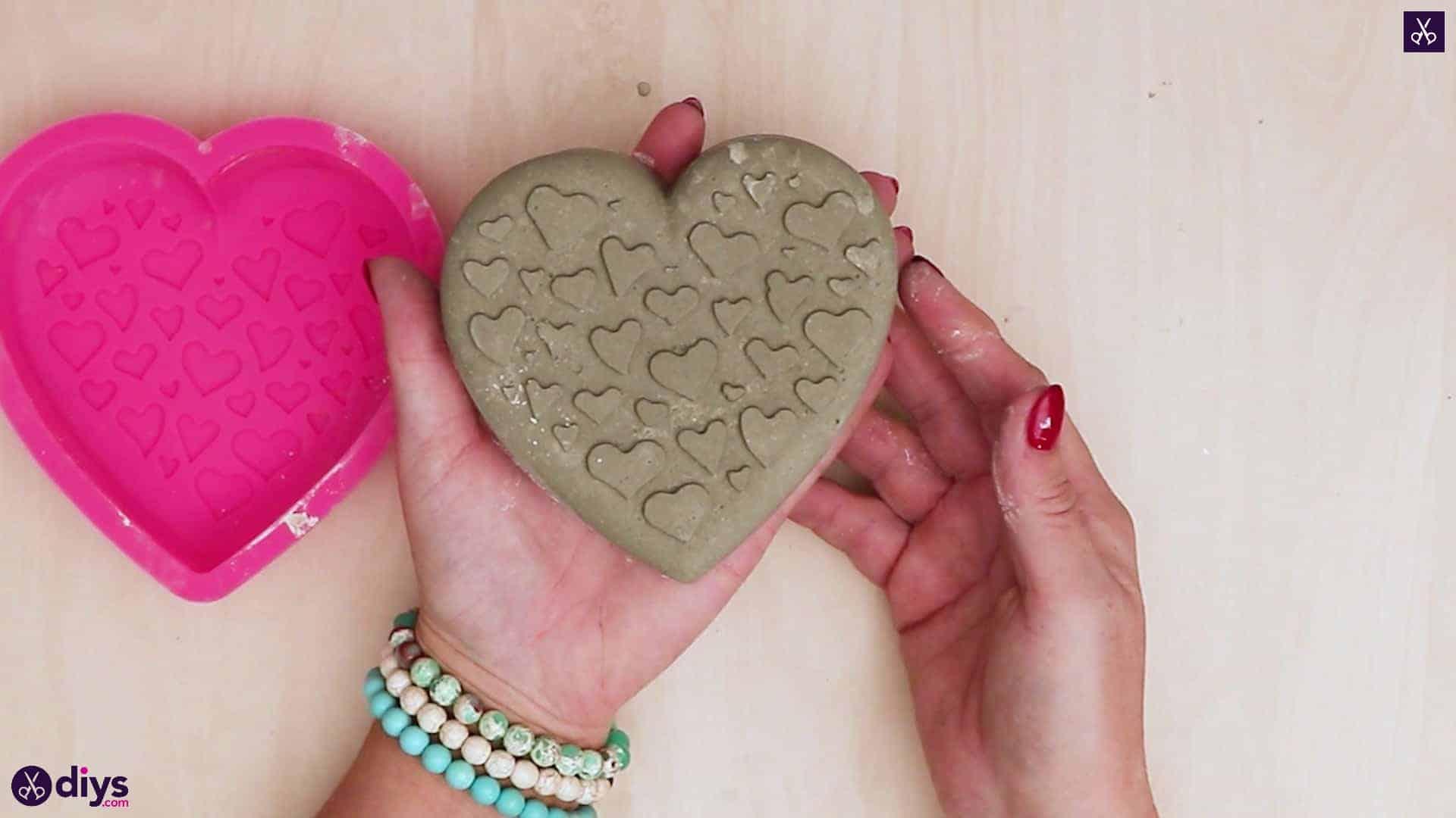 Diy concrete heart candle holder back