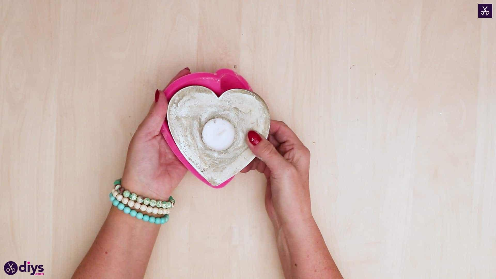 Diy concrete heart candle holder removing mold