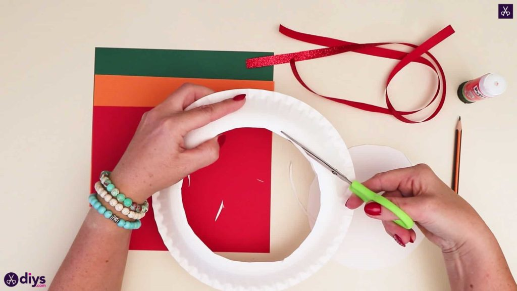 Paper plate wreath with a candle cutting round