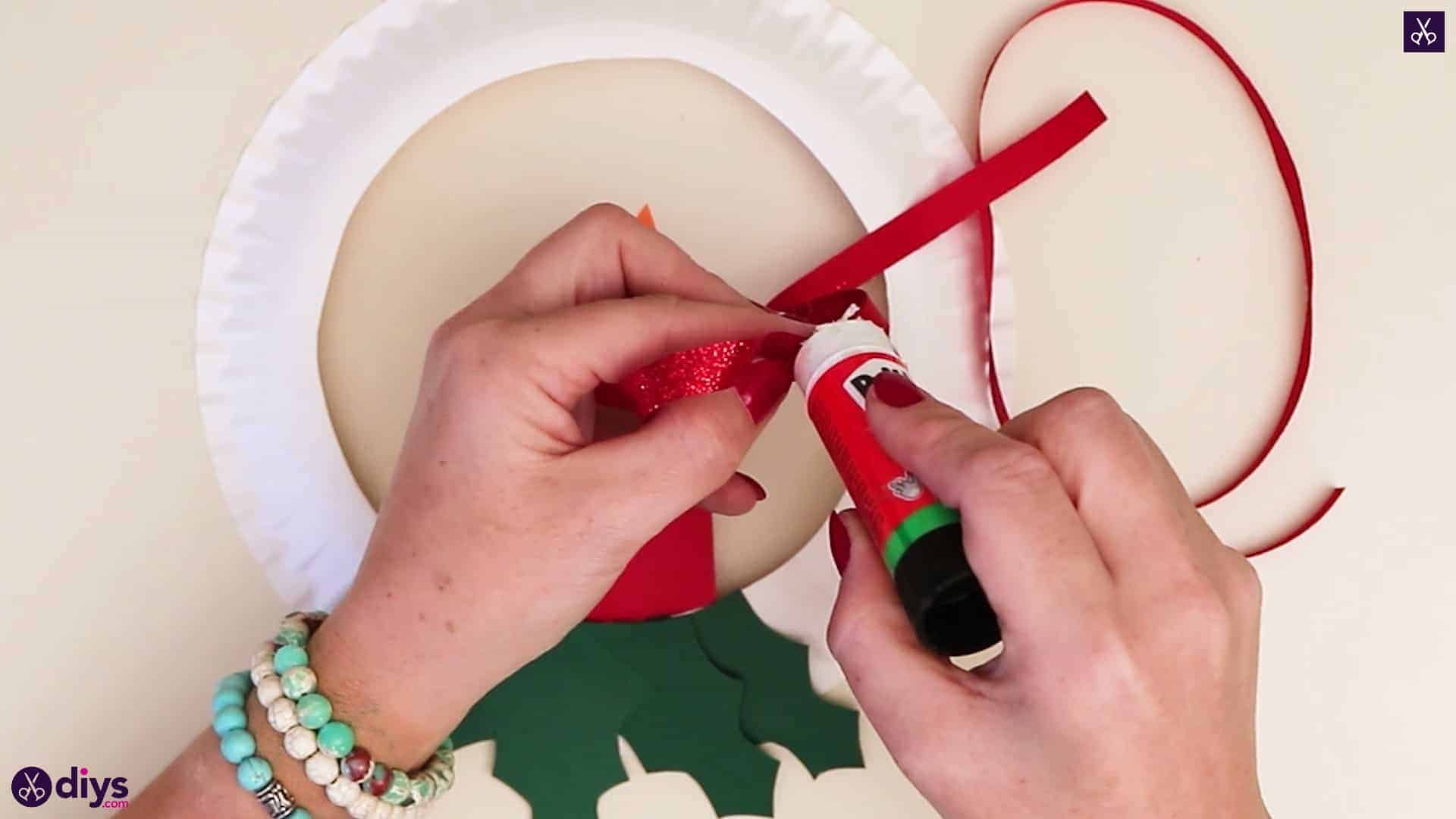 Paper plate wreath with a candle glue
