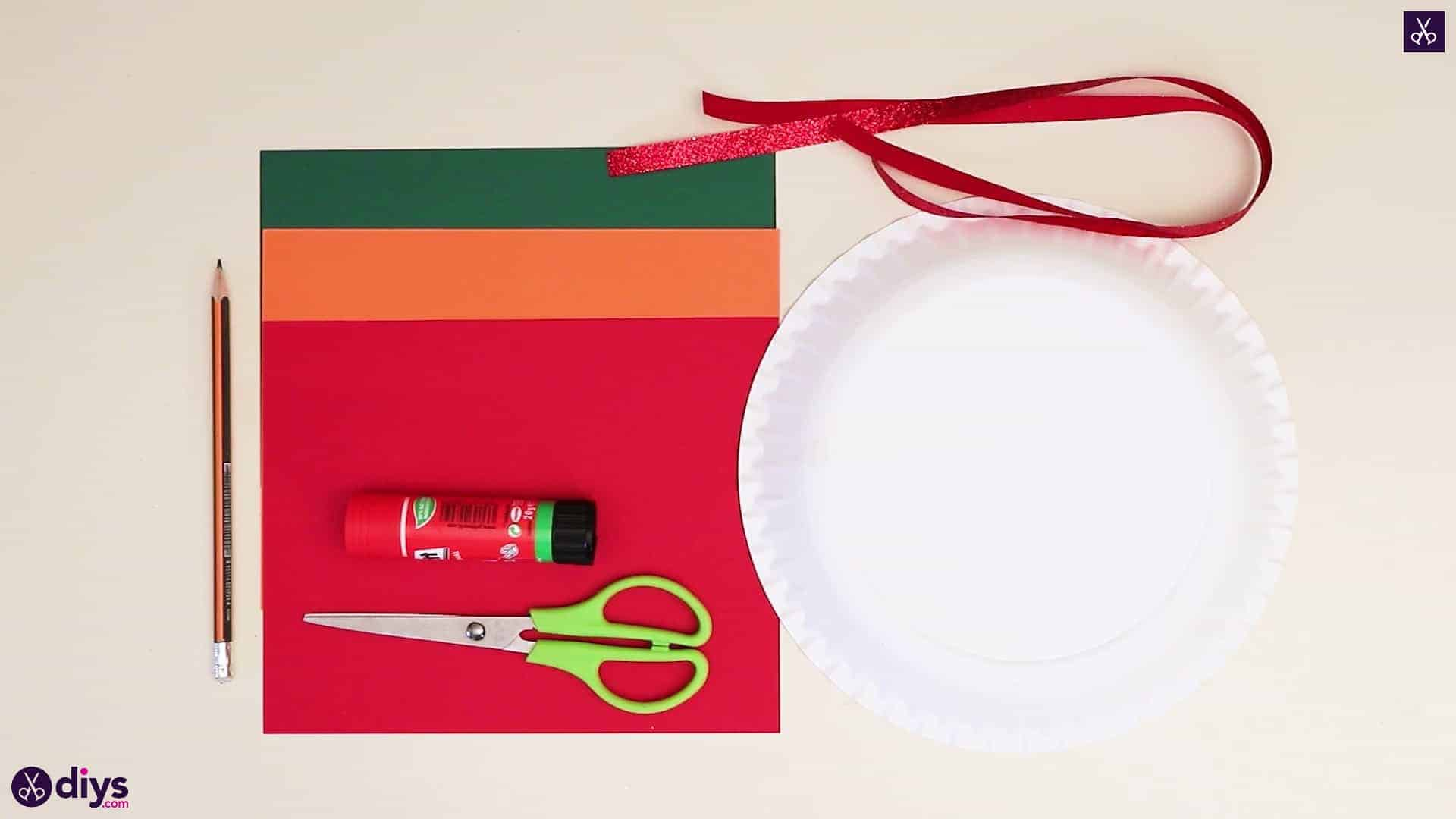 Paper plate wreath with a candle materials