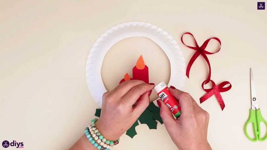 Paper plate wreath with a candle more glue