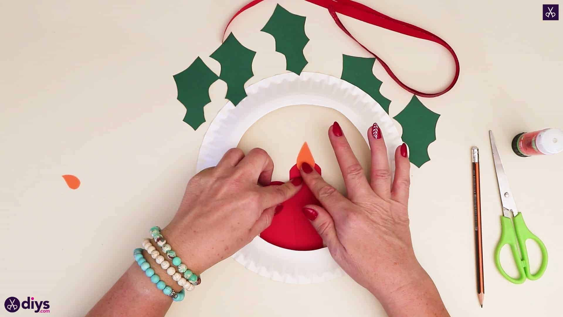 Paper plate wreath with a candle press