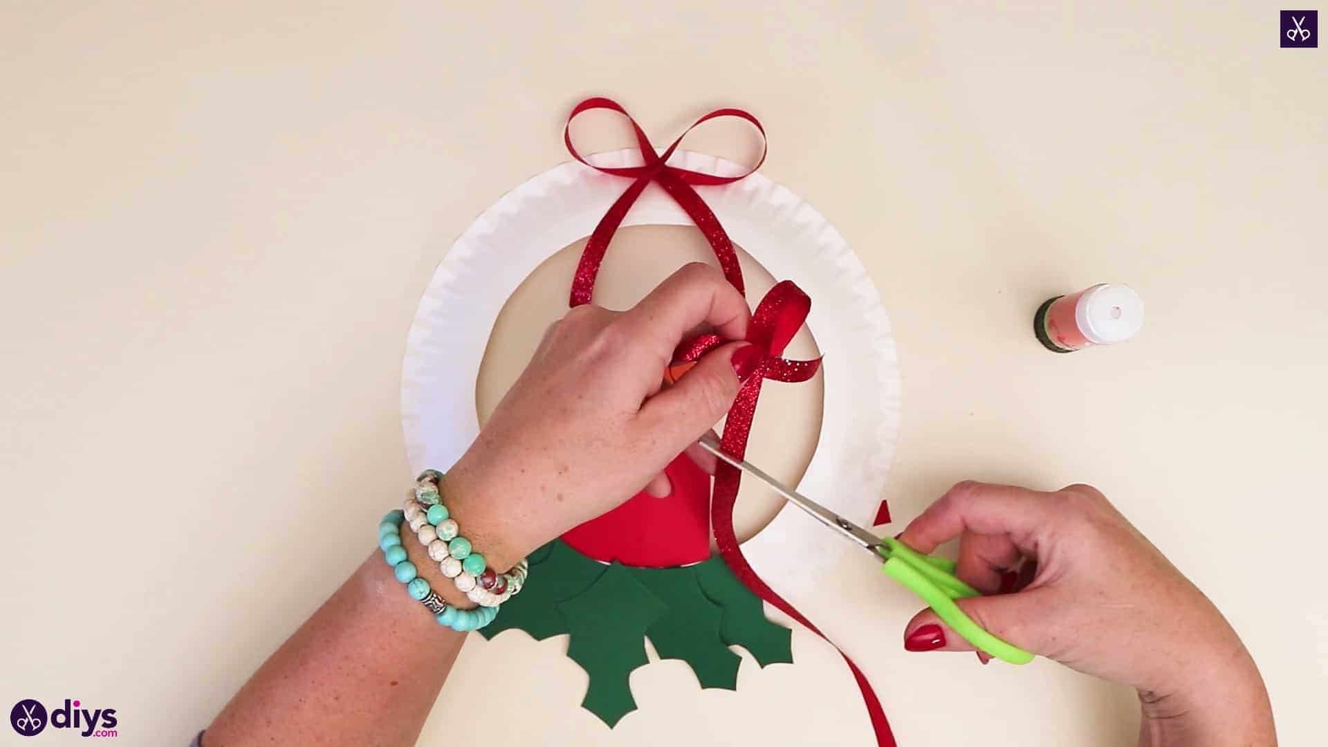 Paper plate wreath with a candle red bow