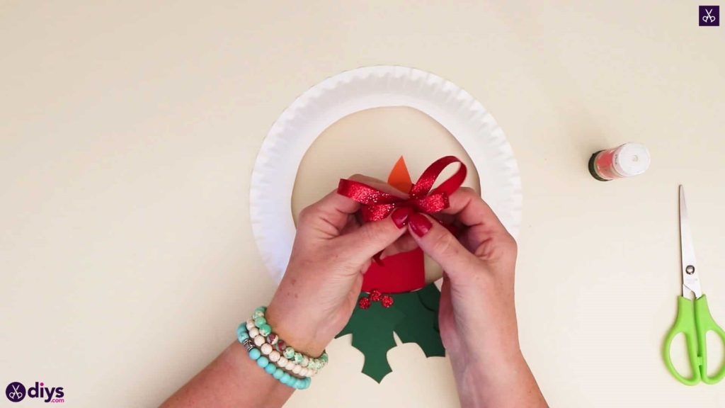 Paper plate wreath with a candle top bow