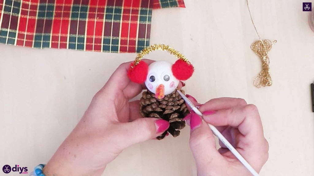 Pinecone snowman with headphones brush