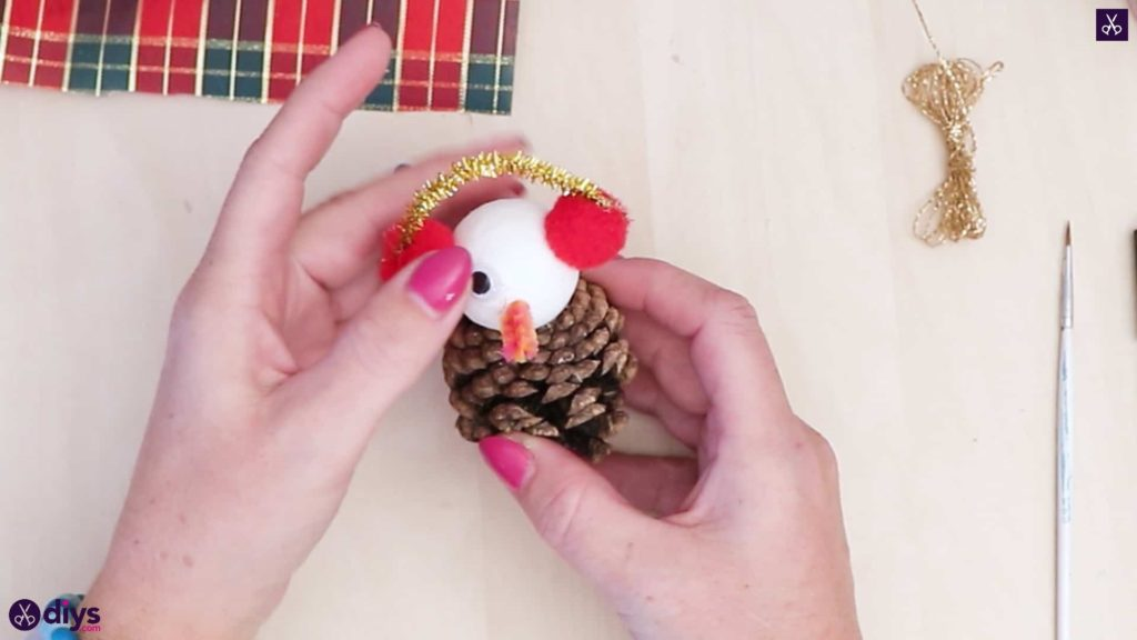 Pinecone snowman with headphones head attach