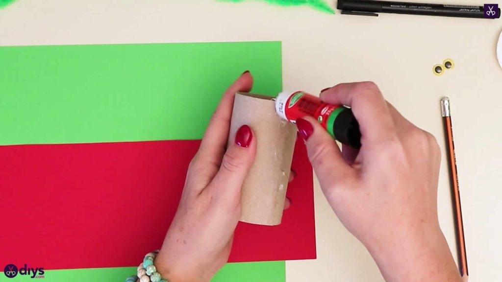 Toilet paper roll grinch add glue