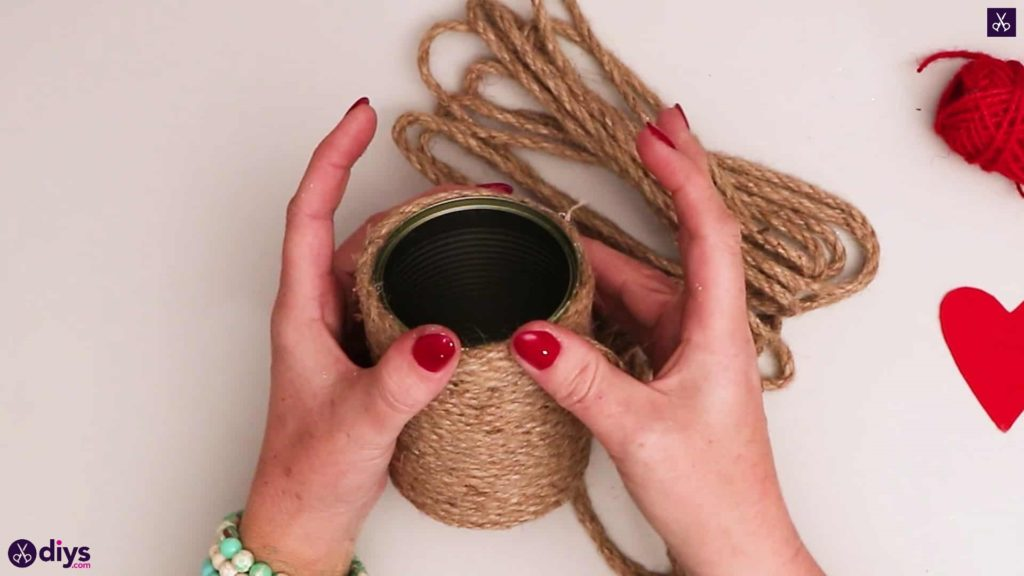 Twine wrapped tin can container press