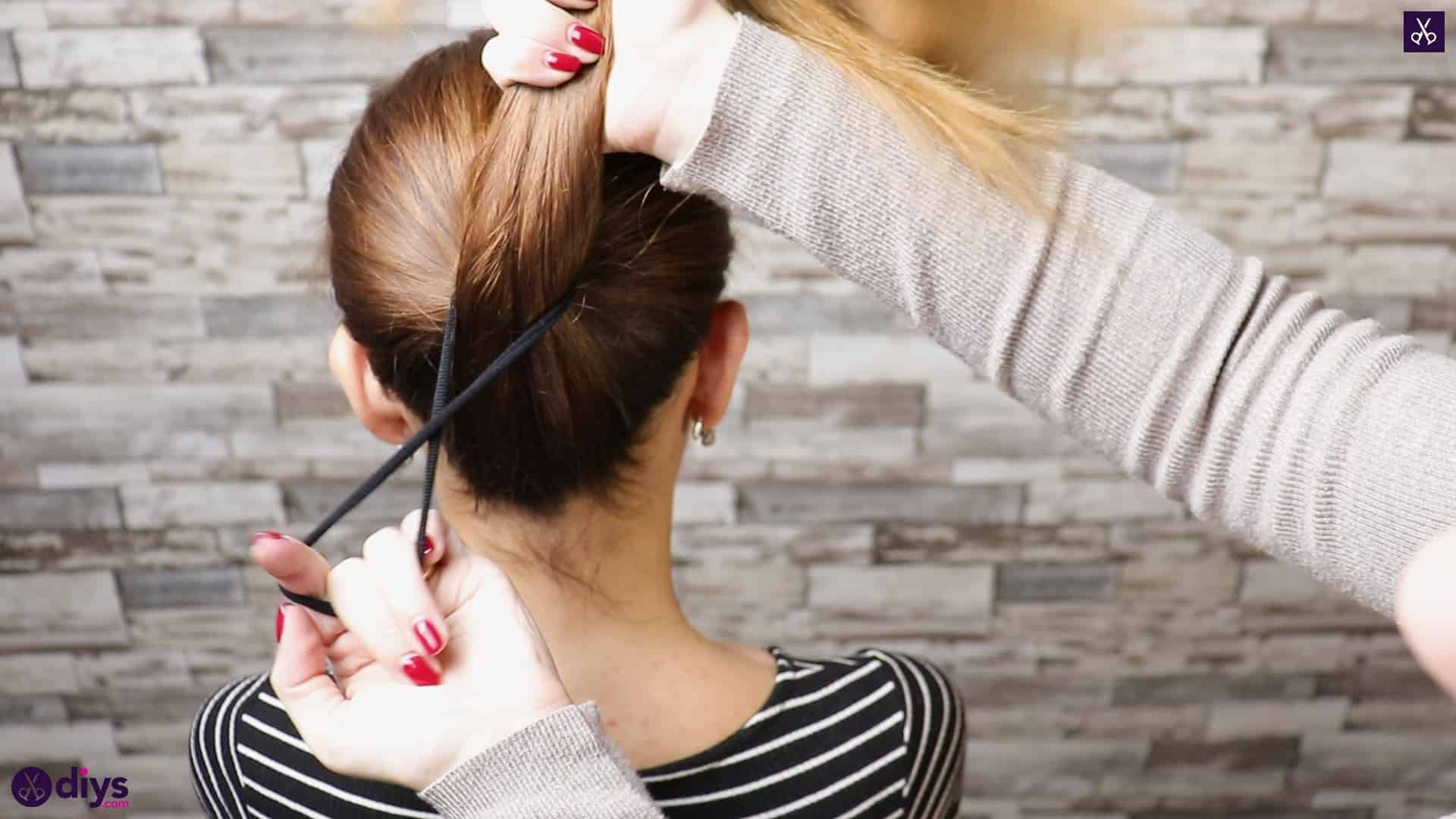 3 easy ponytails for everyday wear twisted ponytail step 1a