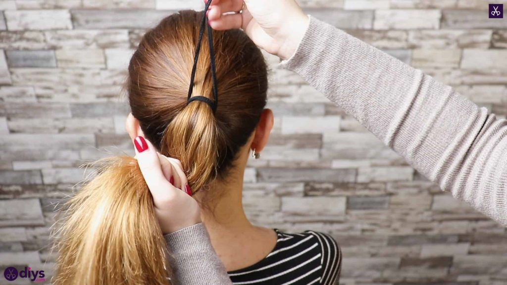 3 easy ponytails for everyday wear twisted ponytail step 1b