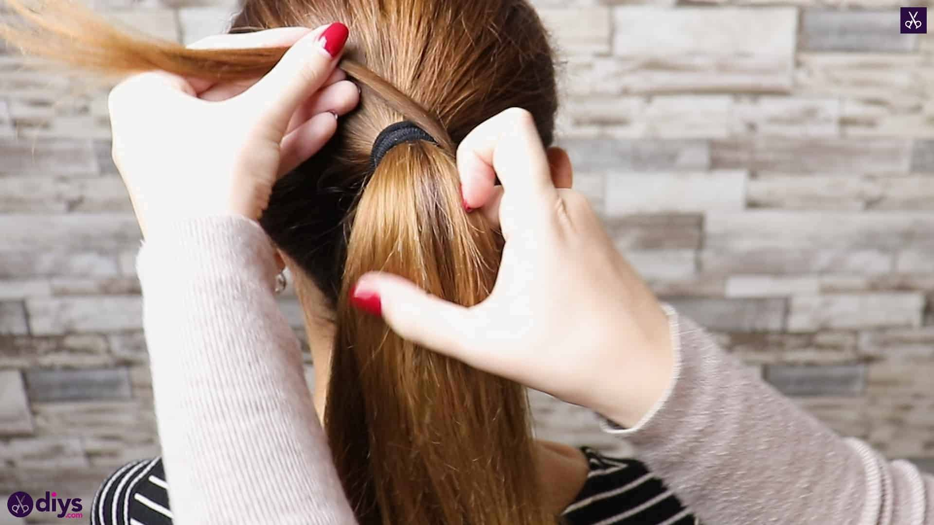 3 easy ponytails for everyday wear twisted ponytail step 2b