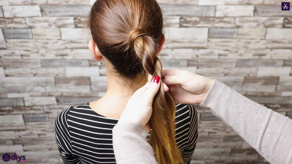 3 easy ponytails for everyday wear twisted ponytail step 3