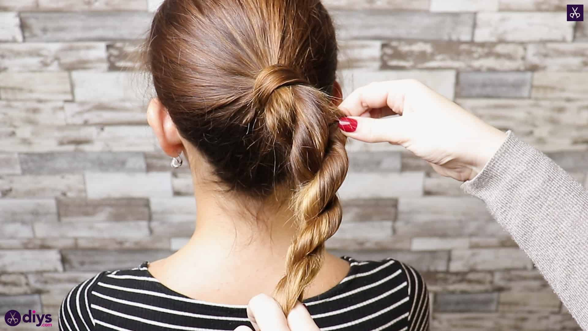 3 easy ponytails for everyday wear twisted ponytail step 4a