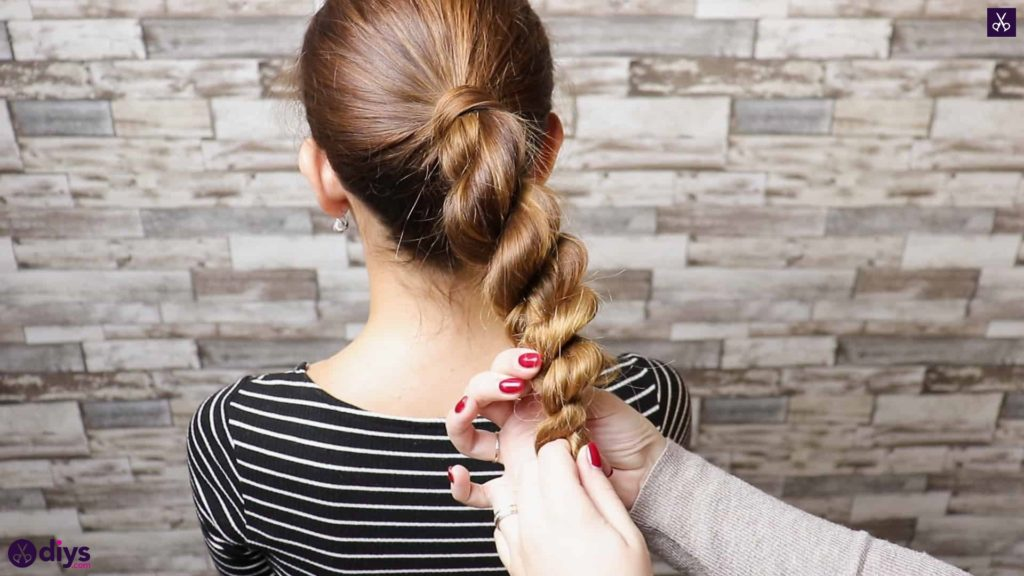 3 easy ponytails for everyday wear twisted ponytail step 4b