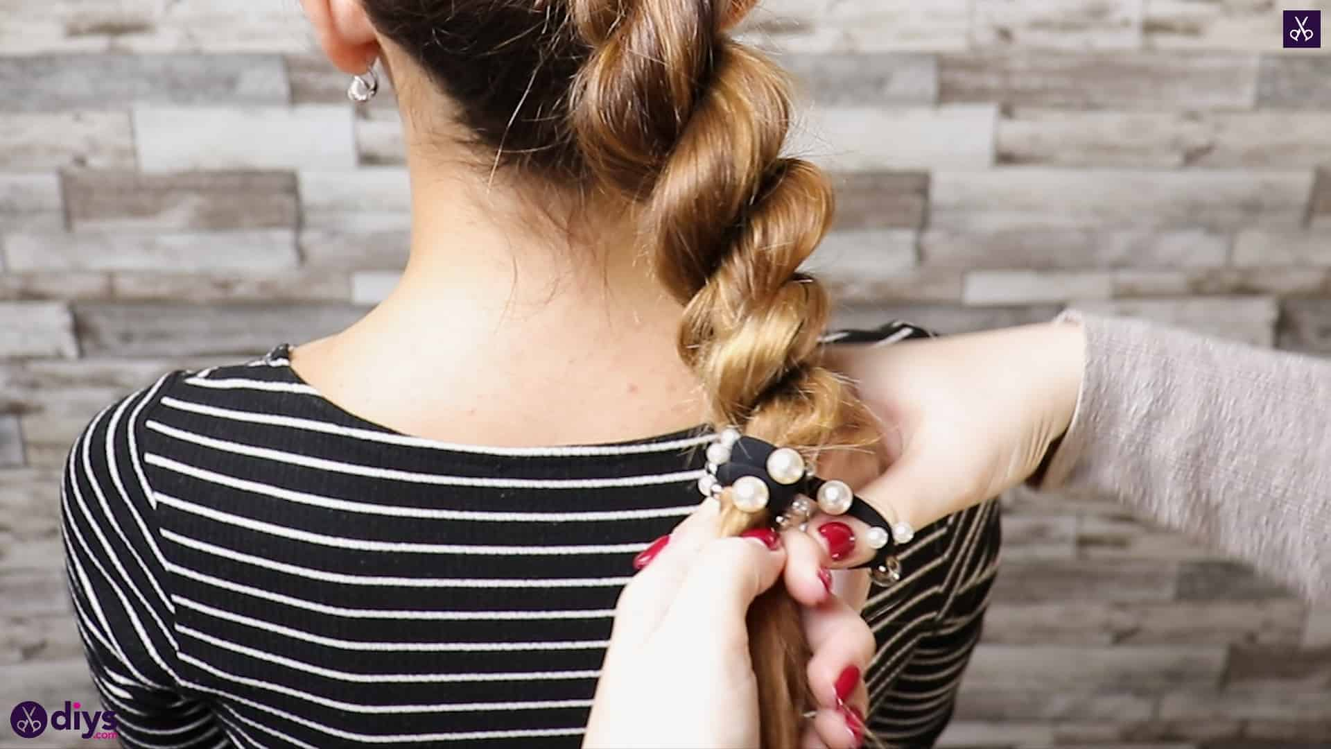 3 easy ponytails for everyday wear twisted ponytail step 5