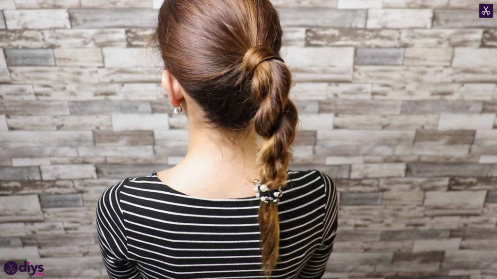 3 easy ponytails for everyday wear twisted ponytail step 5a
