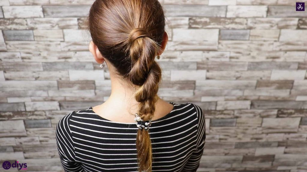 3 easy ponytails for everyday wear twisted ponytail step 5b