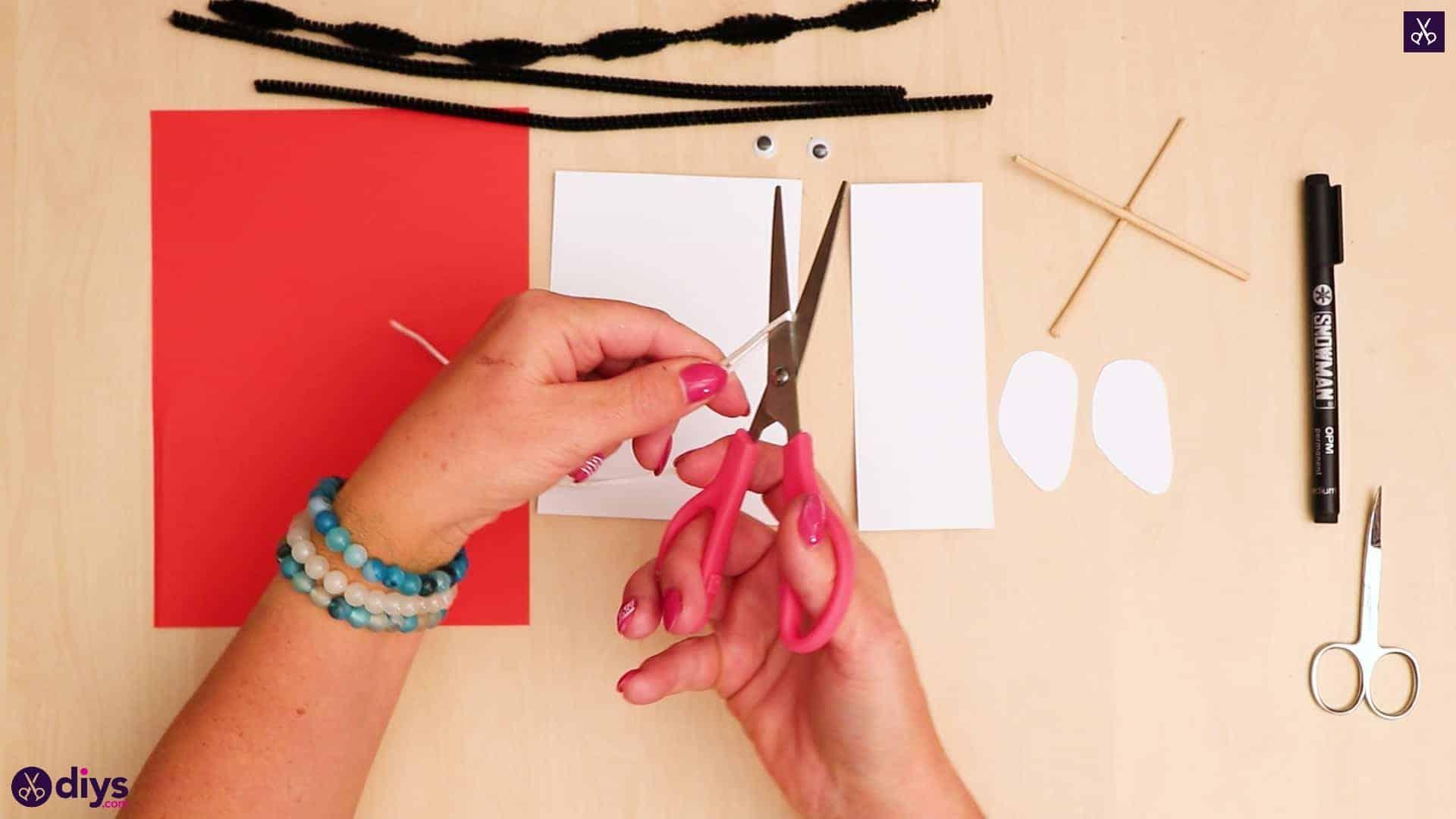 3d paper dog puppet' ribbon cut