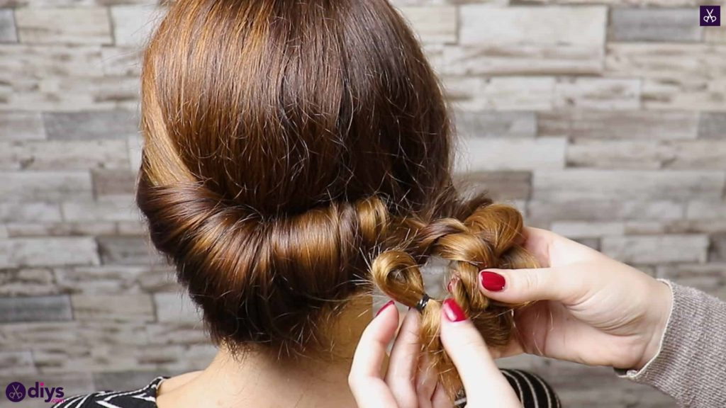 Beautiful summer bun with flowers hairstyle step 4a
