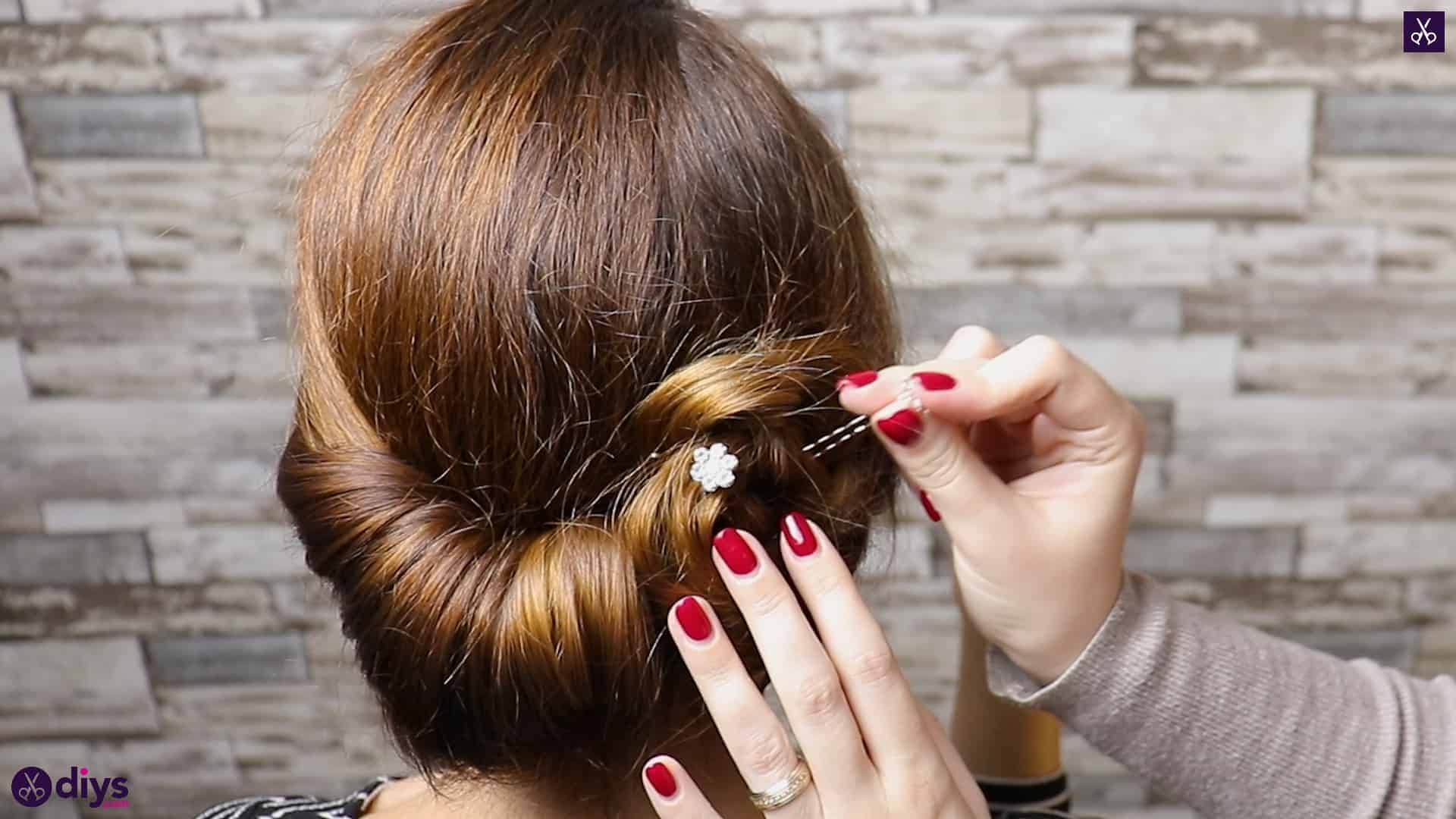 Beautiful summer bun with flowers hairstyle step 5