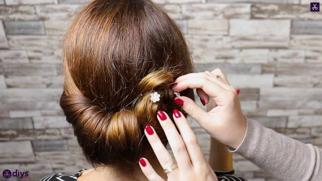 Beautiful summer bun with flowers hairstyle step 5a
