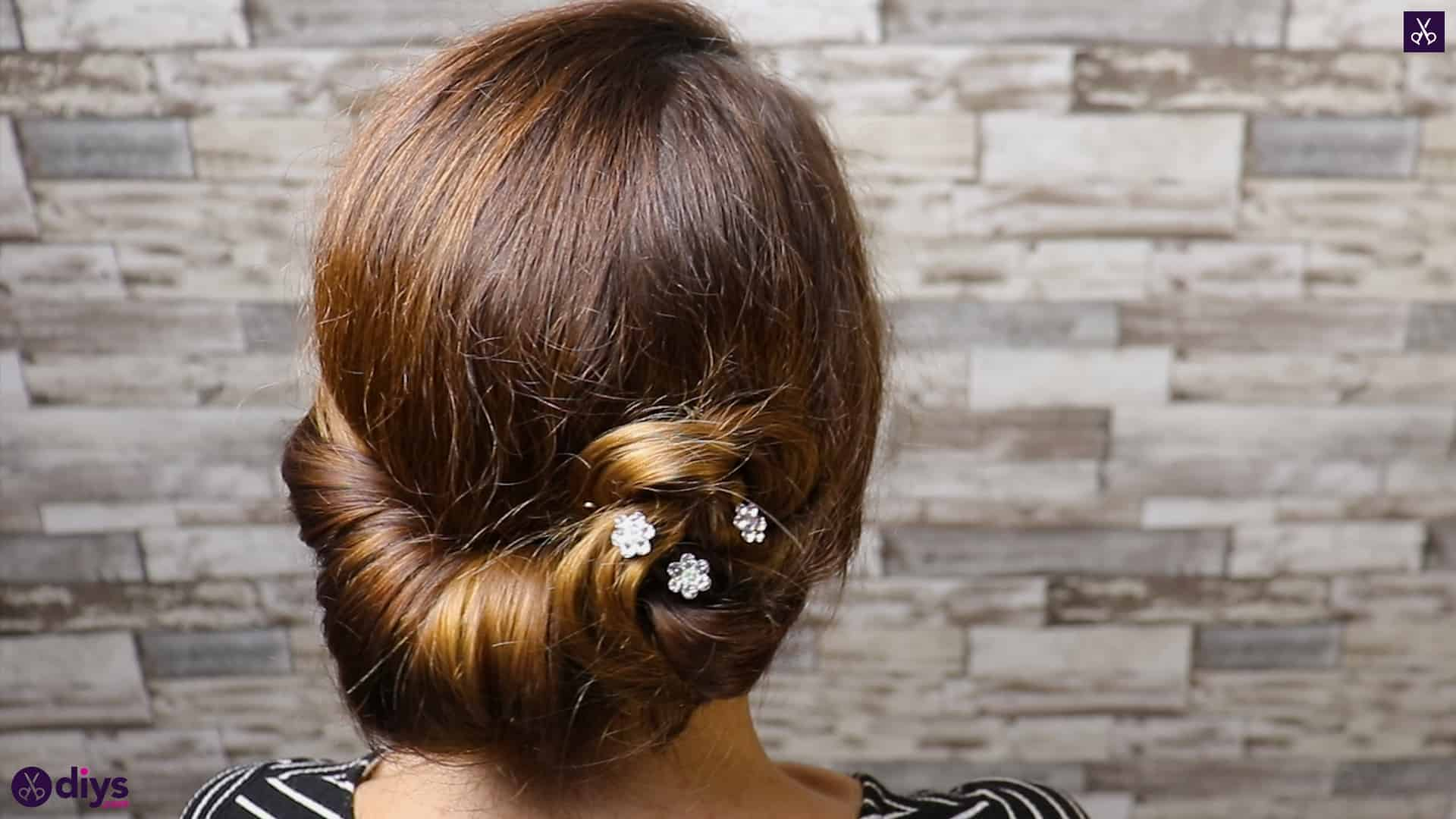 Beautiful summer bun with flowers hairstyle step 5c