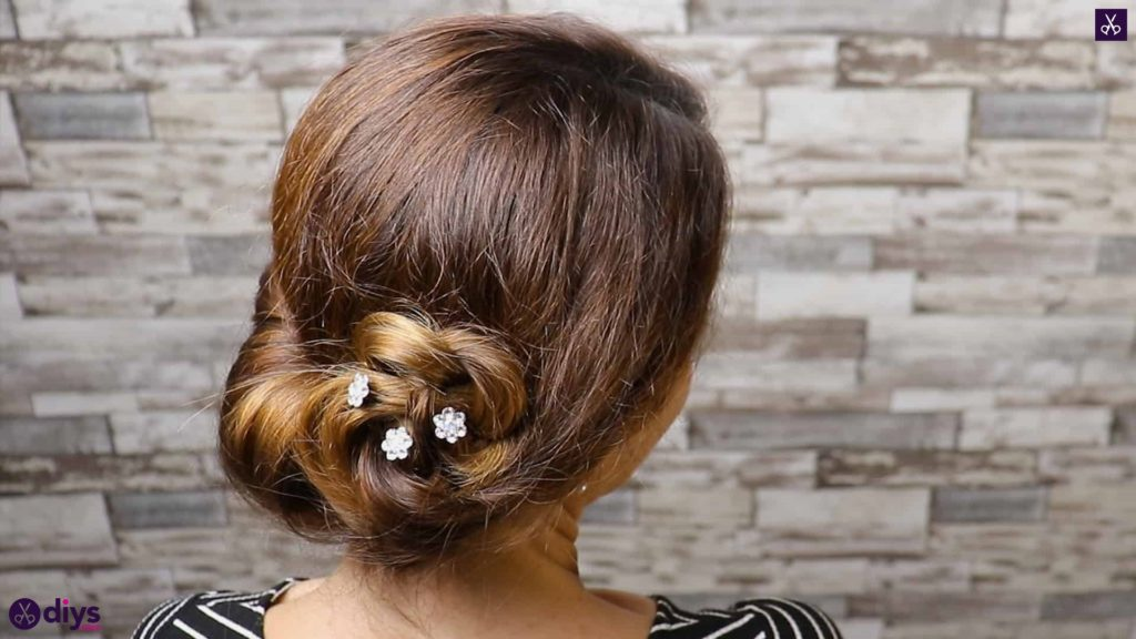 Beautiful summer bun with flowers hairstyle step 5d