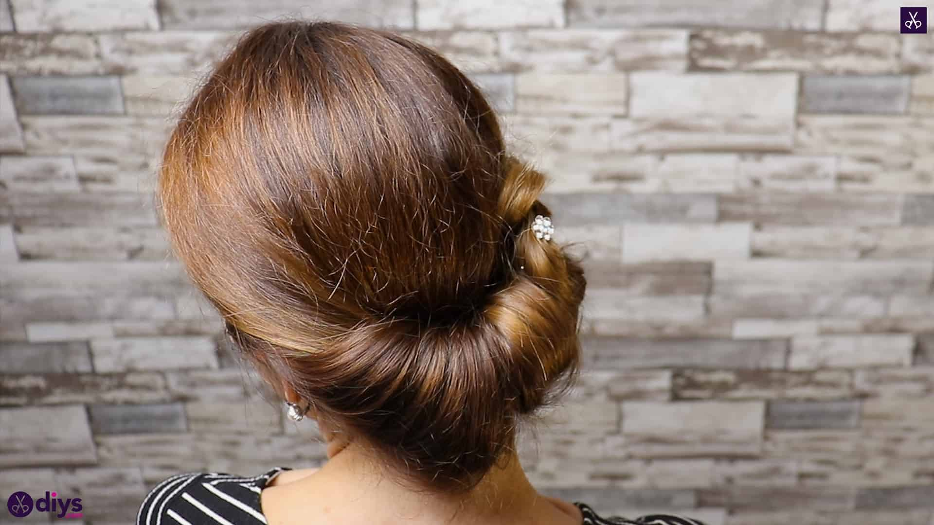 Beautiful summer bun with flowers hairstyle step 5e