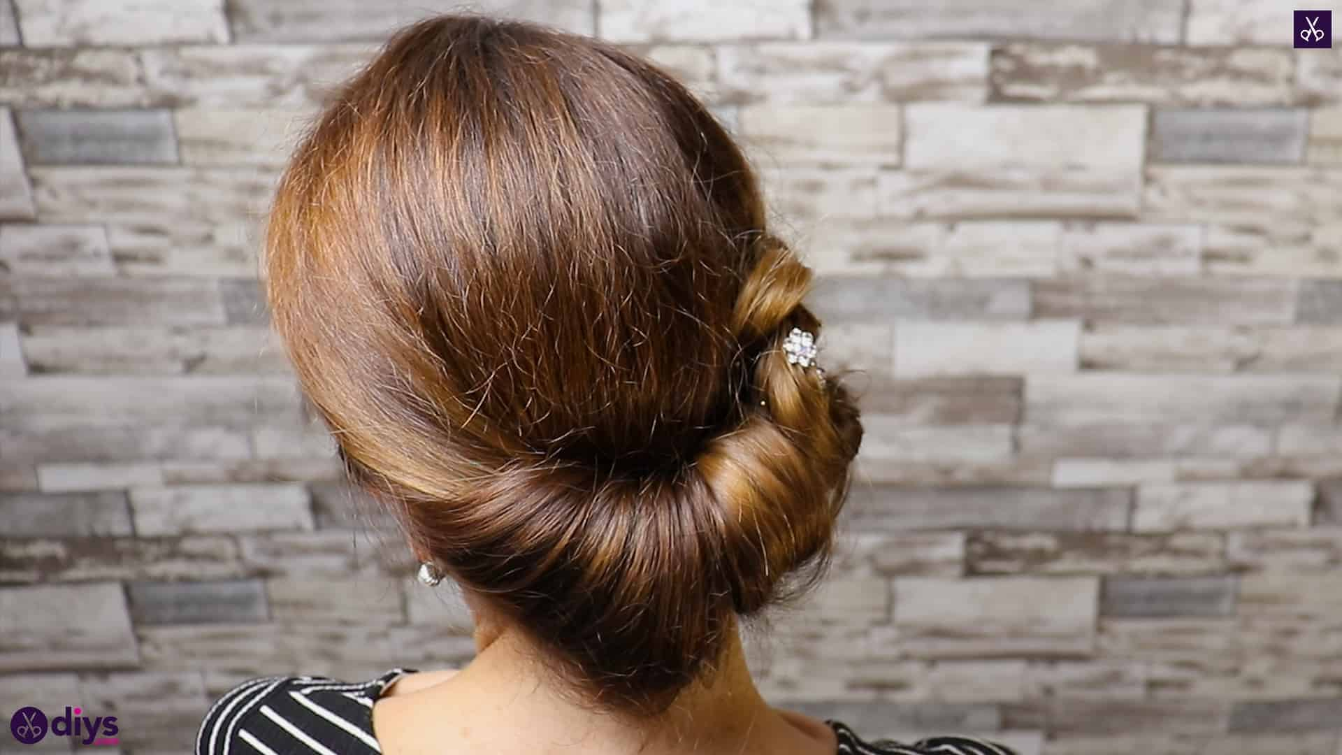 Beautiful summer bun with flowers hairstyle