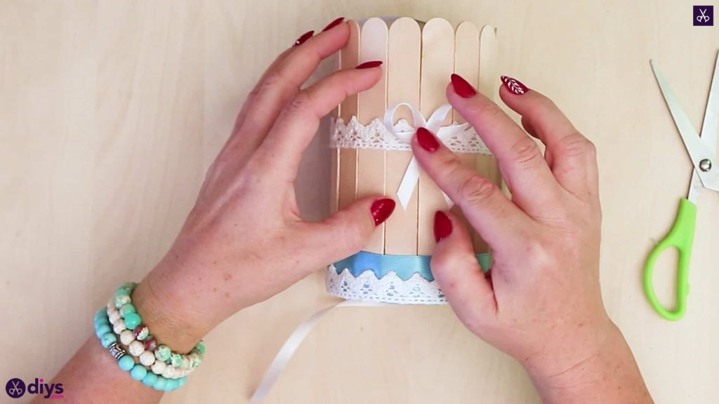 Elegant popsicle stick covered tin container bow