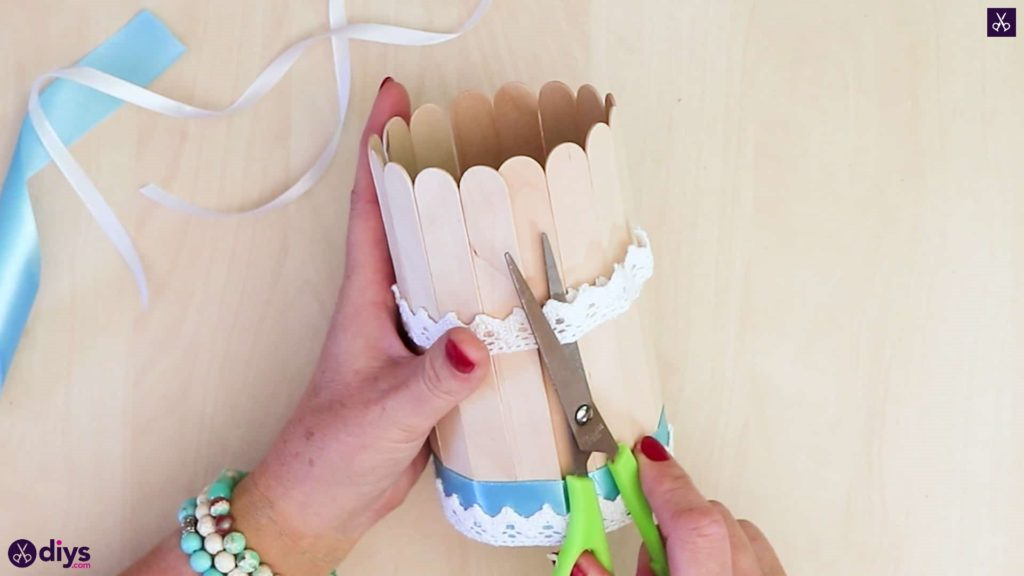 Elegant popsicle stick covered tin container cuttign lace