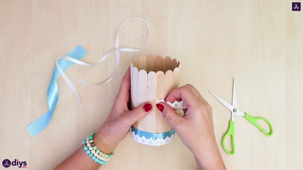 Elegant popsicle stick covered tin container half ribbon
