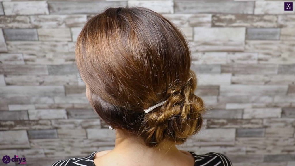 Elegant and easy wedding bun hairstyle for guests step 1