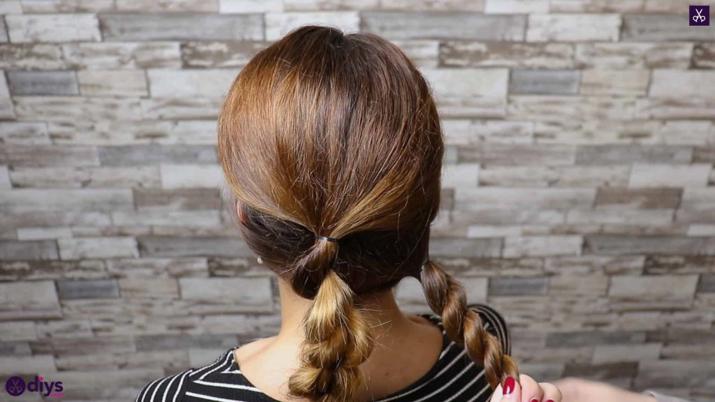 Elegant and easy wedding bun hairstyle for guests step 2d