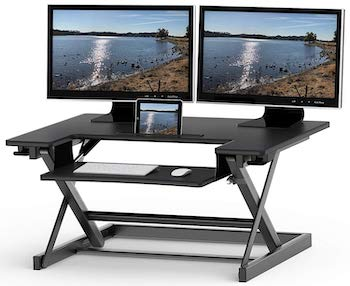 Height adjustable sit to standing desk converter riser workstation