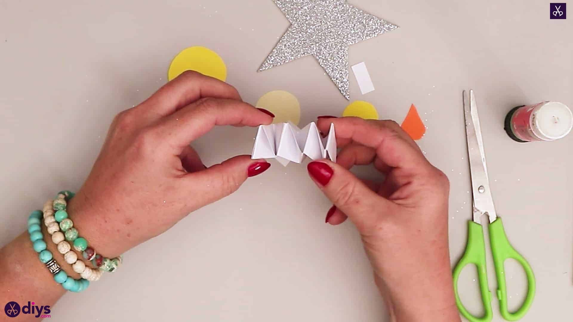 Paper candle on a star accordion