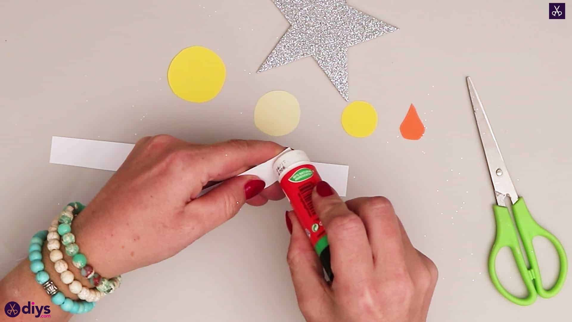 Paper candle on a star adhesive