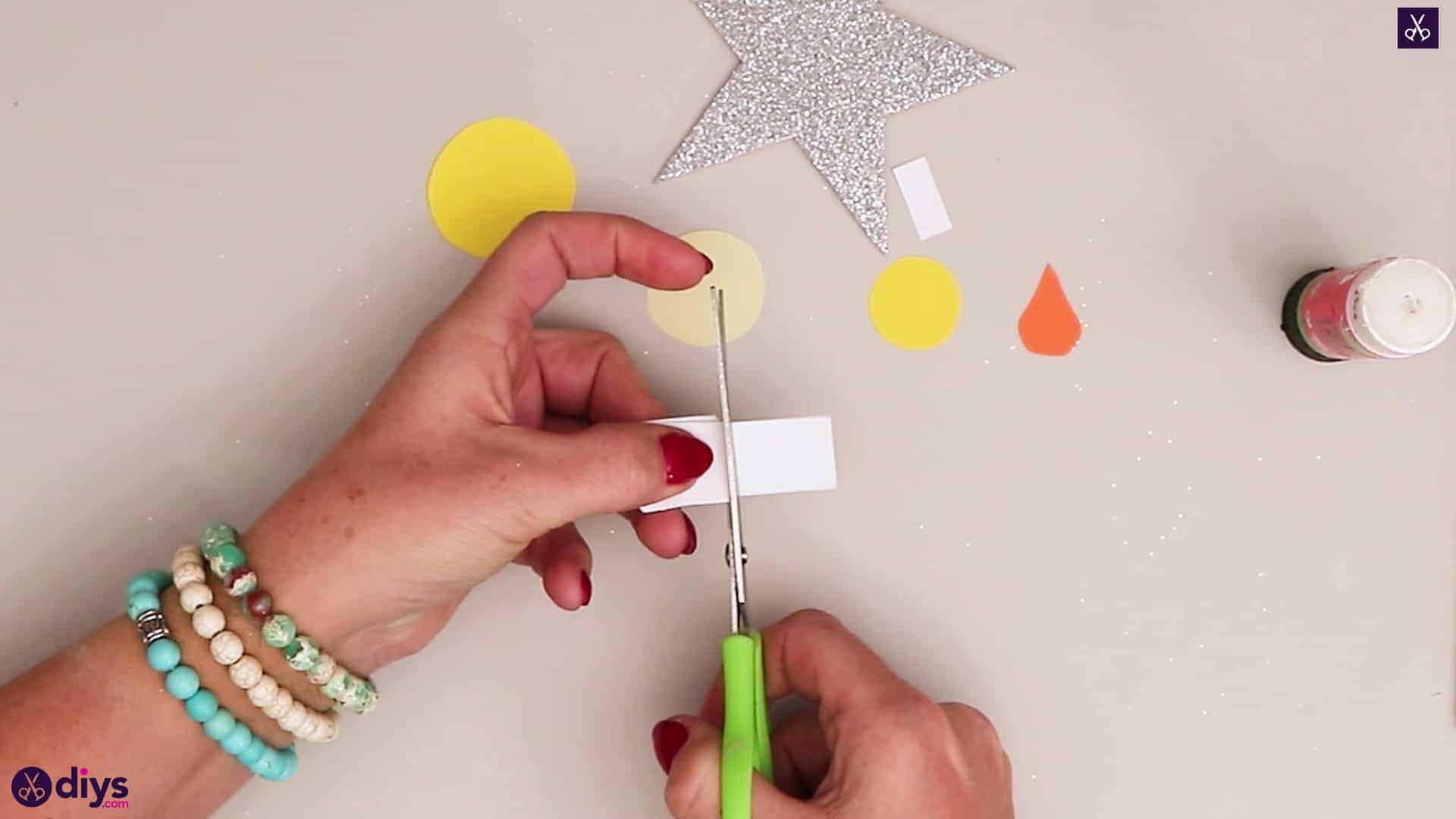 Paper candle on a star cutting slice
