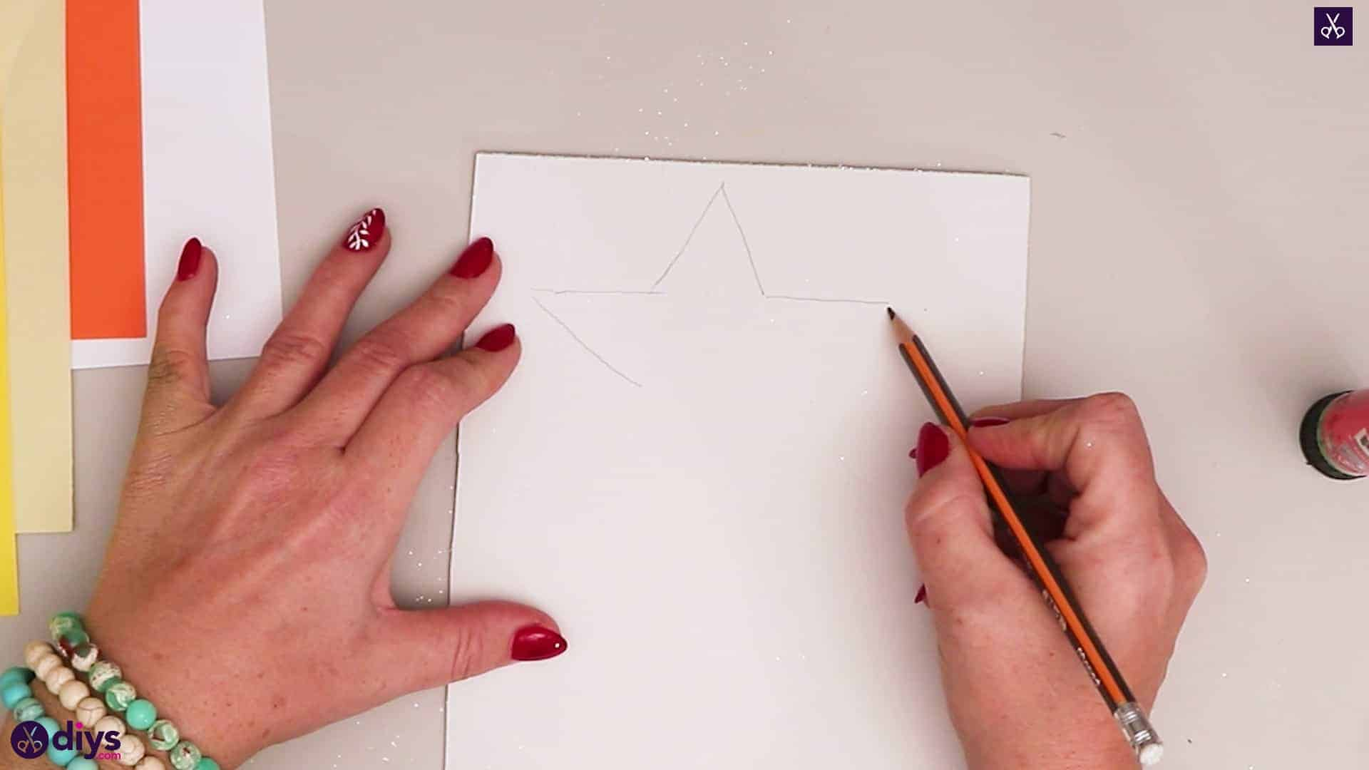 Paper candle on a star drawing