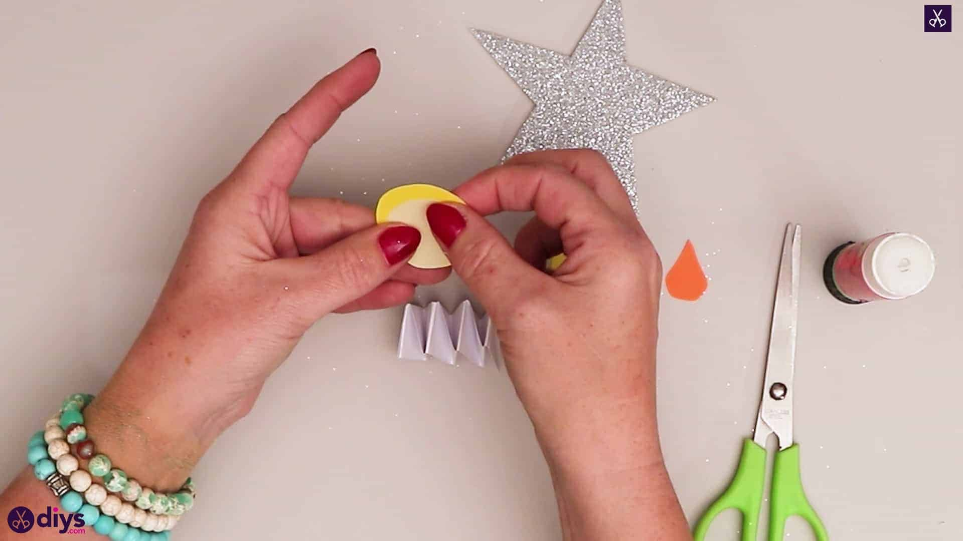 Paper candle on a star glue al