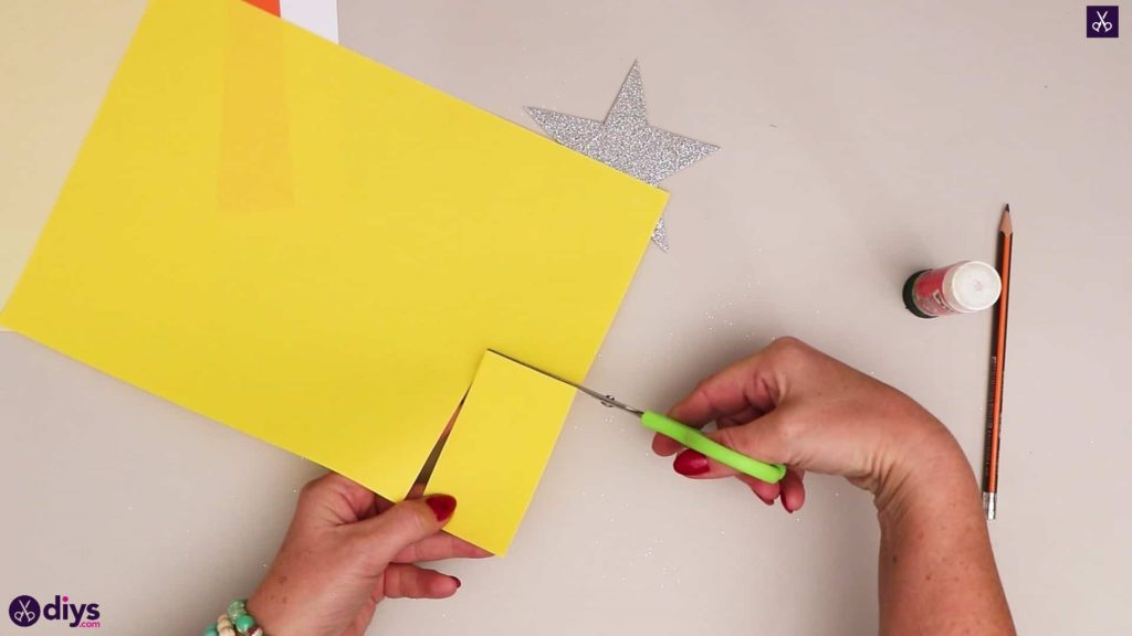 Paper candle on a star lay down yellow paper