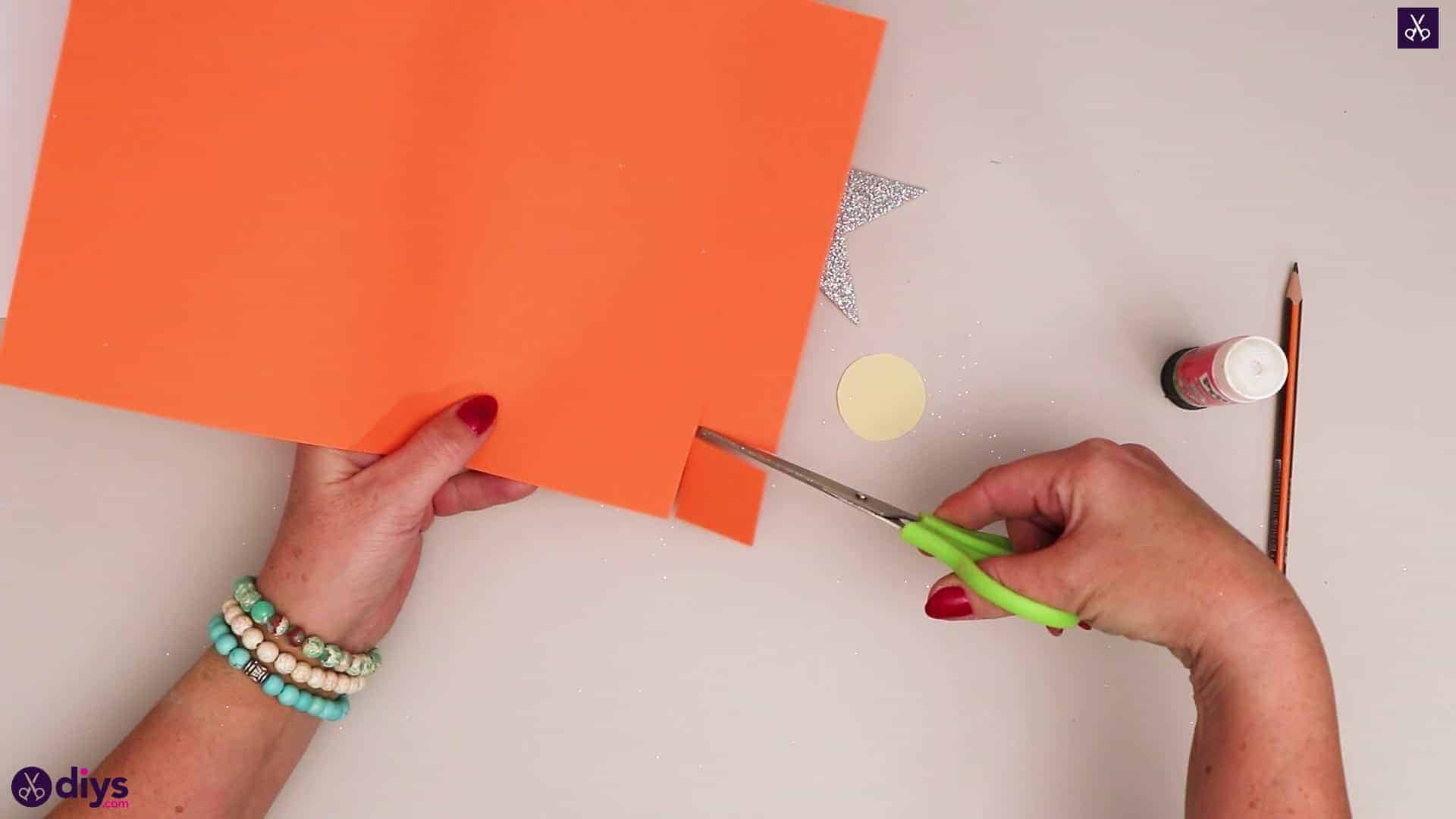 Paper candle on a star orange paper