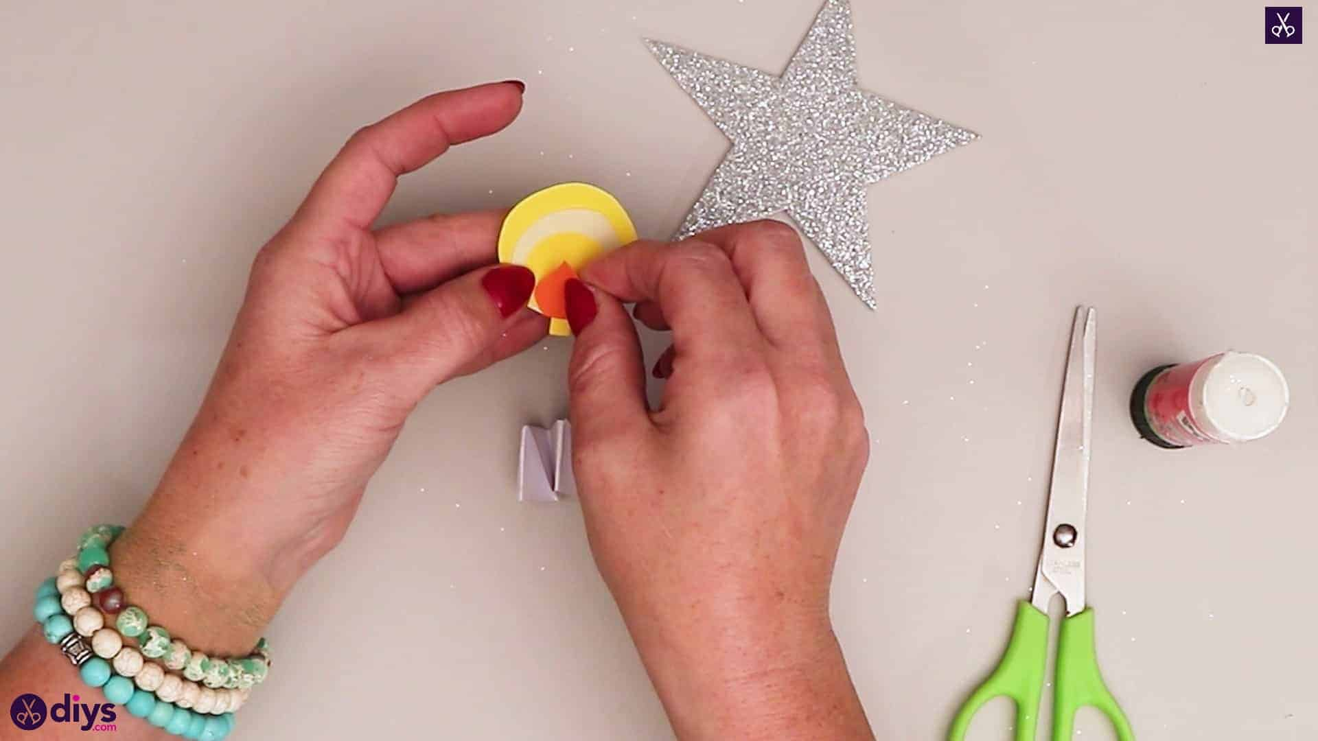 Paper candle on a star orange