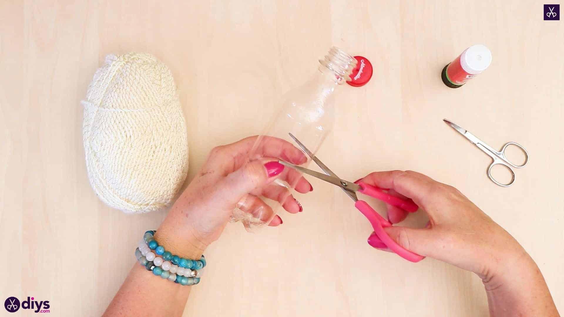 Plastic bottle pom pom ornament cutting half