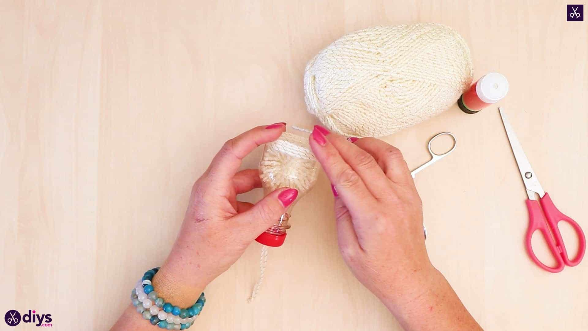 Plastic bottle pom pom ornament step 9