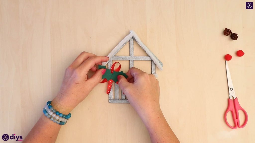 Popsicle stick house ornament attach