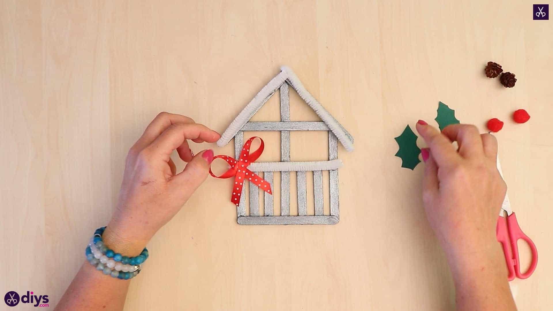 Popsicle stick house ornament glue add accessories
